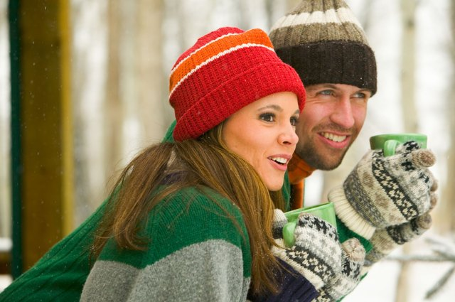 Couple with mugs of hot chocolate