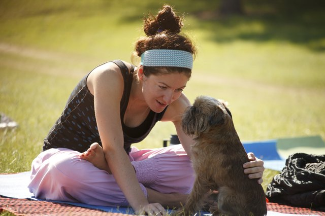 Yoga girl with her dog