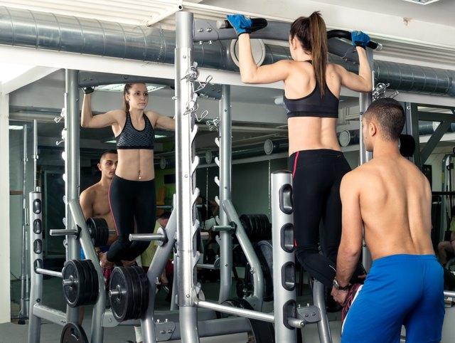 Female Athlete Doing Pull Ups.