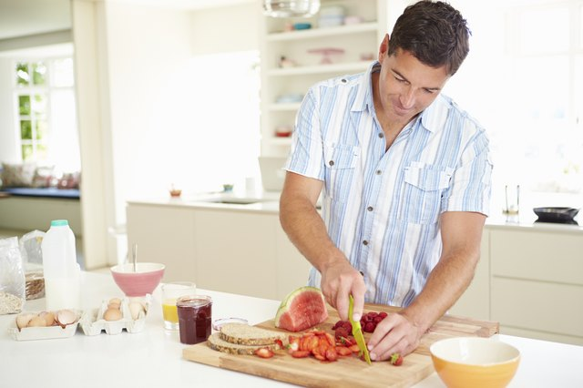 Man Preparing Healthy Breakfast In Kitchen
