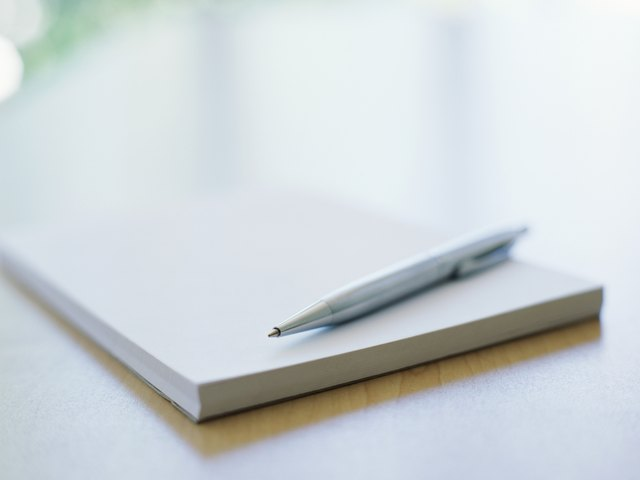 close-up of a pen on a notebook