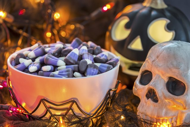 Purple candy corn in a spooky Halloween theme