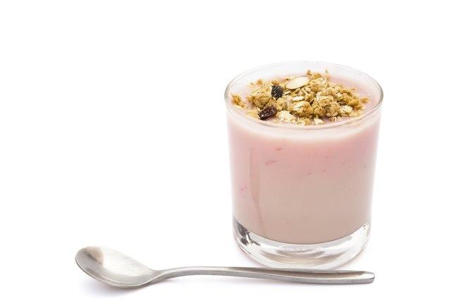 wholegrain muesli on top of strawberry flavor yogurt