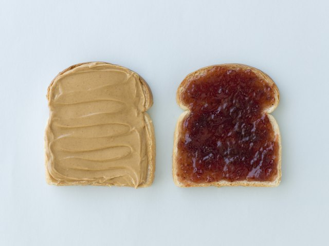 Slices of bread with peanut butter and jelly
