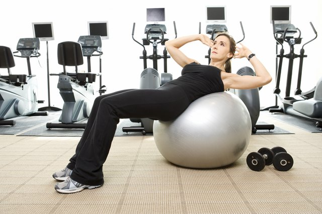 Woman doing sit-ups on exercise ball