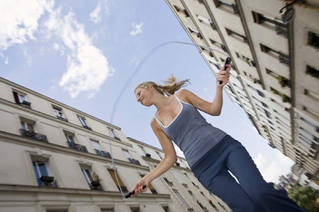 Woman jumping rope in city