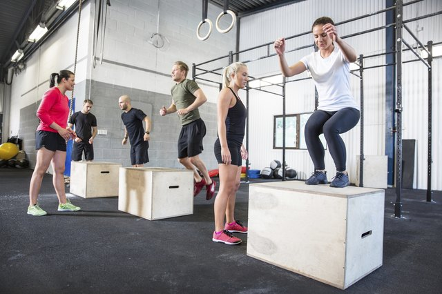 Crossfit group trains box jumps