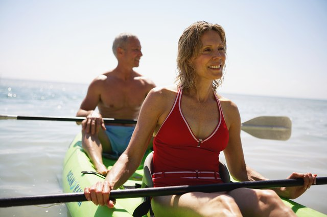 Senior couple in kayak smiling, close-up