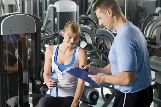 Completing personal fitness plan with trainer