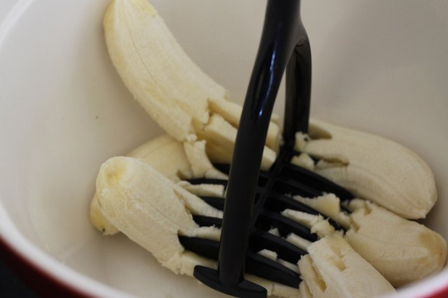 A potato masher works best but a fork would also do for very ripe bananas.