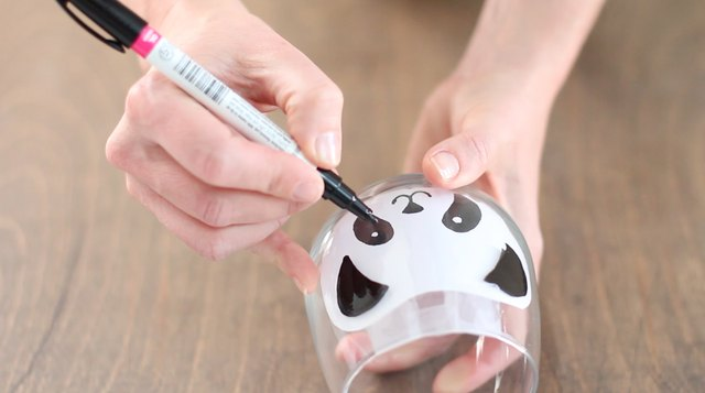 Draw the panda face onto the glass.