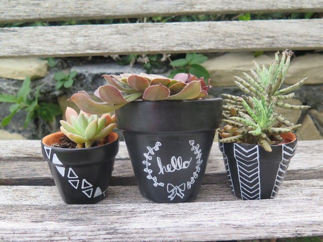 Chalkboard paint and pens turn terra-cotta plant pots into custom creations