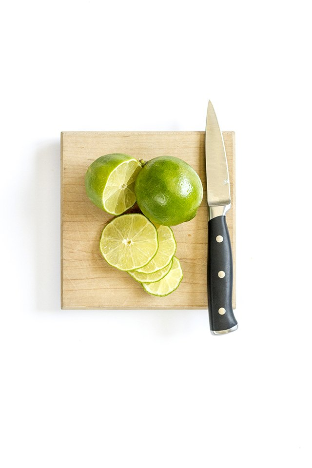 Cut two limes into several even slices.