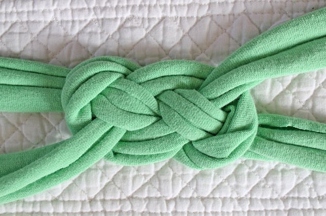Pull the ends to create the knot.