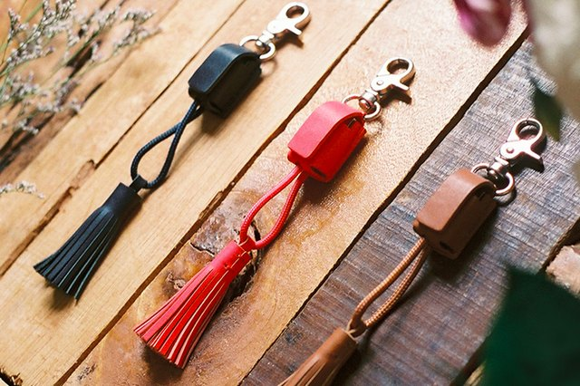 The POWER Link Tassel is a keychain that charges your phone.