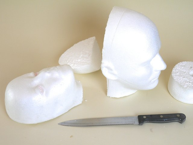 Remove the back of the foam heads with a hand saw or serrated kitchen knife.