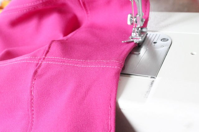 Fold the waistband facing under and topstitch.