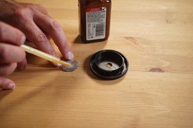 Using contact cement to glue the lens into the body cap