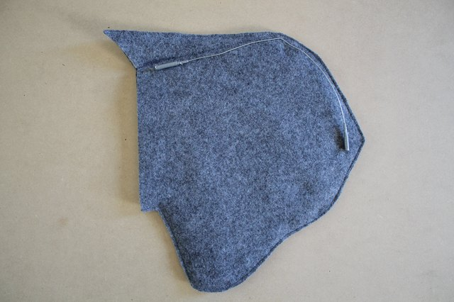 Add duct tape to the sharp ends of the wire.