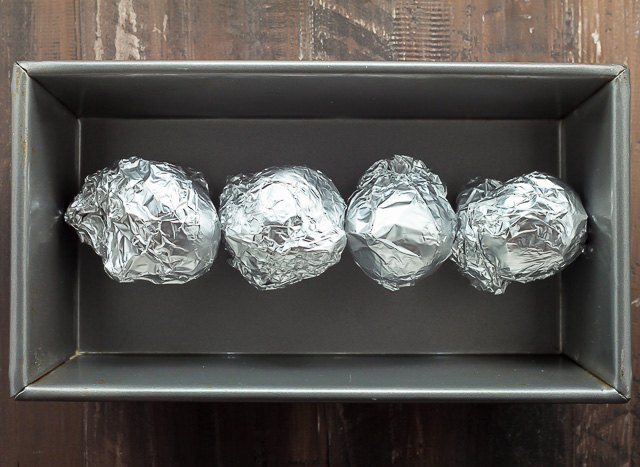 Wrap each beet in foil, and place them on a baking sheet.
