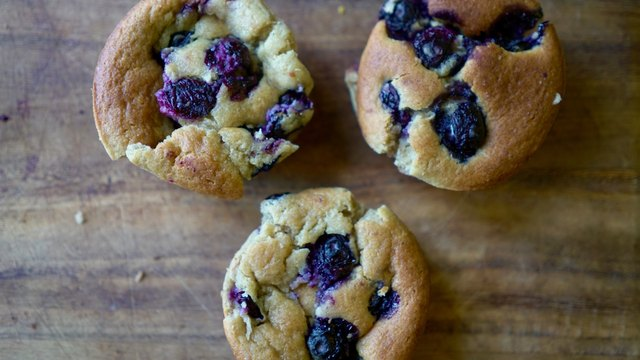 Nut butter banana muffins made with almond butter and topped with blueberries