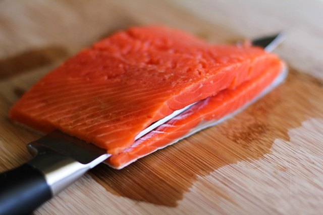 Slice the salmon through the middle.