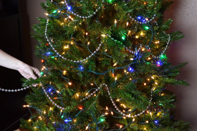 ... in between the tree branches after wrapping the beaded string around  the tree two or three times. This creates a more pleasing visual effect  rather than ... - How To String Beads On A Christmas Tree (with Pictures) EHow