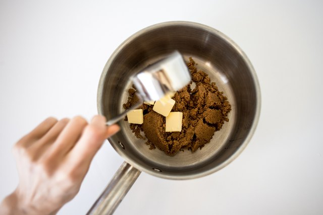 Combine the butter and  brown sugar in a saucepan.
