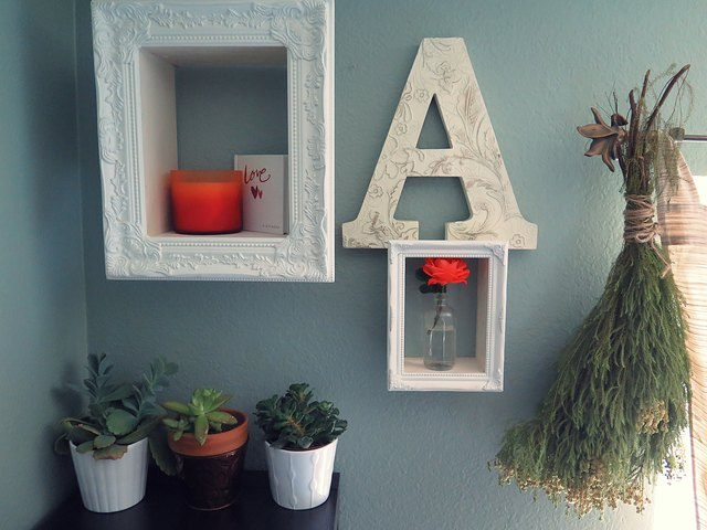 A pretty way to display candles, book, and flowers.