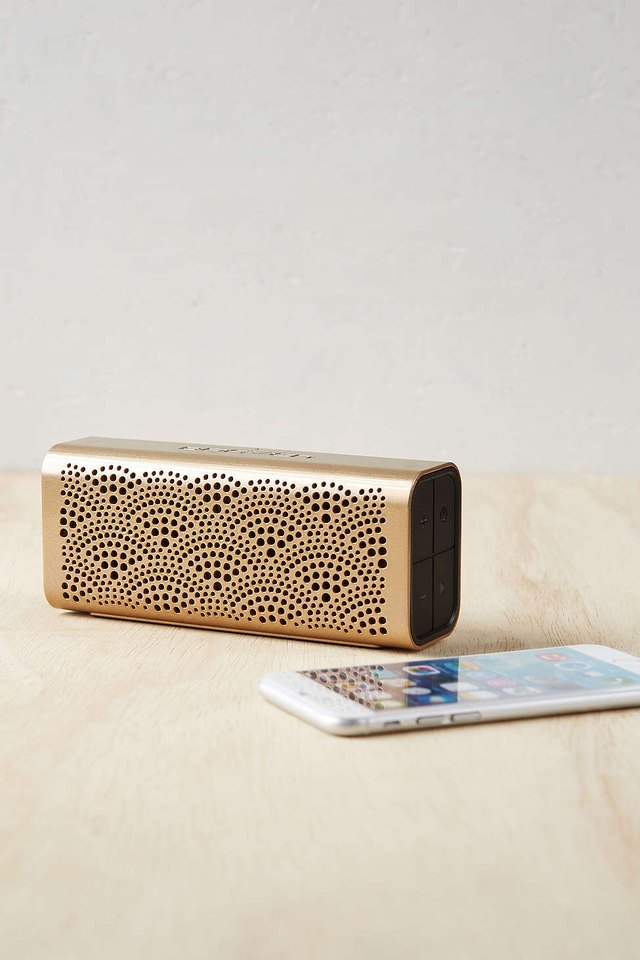 Modern mini speaker enhances the sound from your Bluetooth-compatible device.