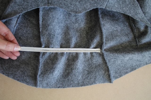 Stitch the elastic to the hood by stretching it while you sew.