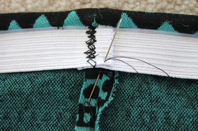 Tack the elastic down to the skirt on the back seam.