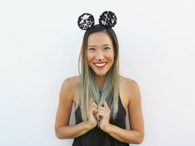 Wearing the lace mouse ears.