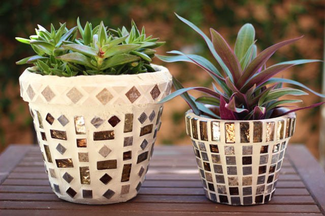 Tiny ceramic tiles give terra-cotta pots a fresh new look.