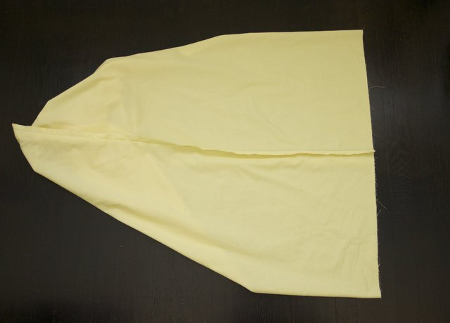 The open seam folded perpendicular to the sewn short seam.