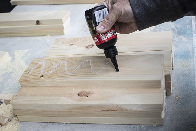 Applying adhesive to wood