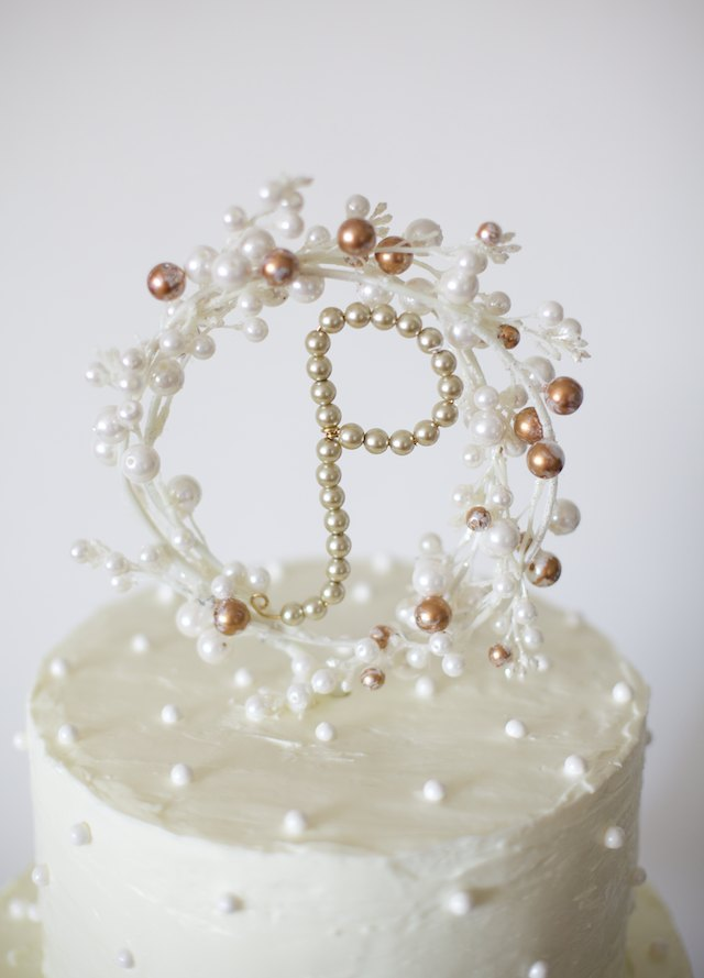 Showcase your new joint last name with a beautiful beaded cake topper.