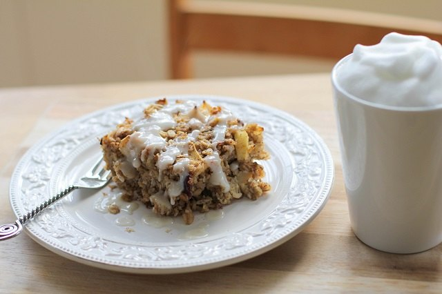 A powdered sugar glaze completes apple walnut baked oatmeal.