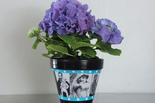Decoupage photos onto a painted pot for a personalized gift.