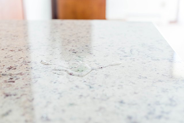 Check to make sure the granite sealer worked by sprinkling a bit of water on the counter.