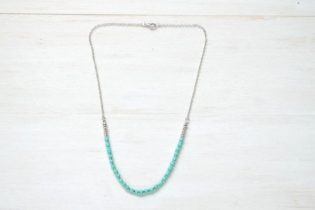 The standard length of a short necklace is 16  to 18 inches long.
