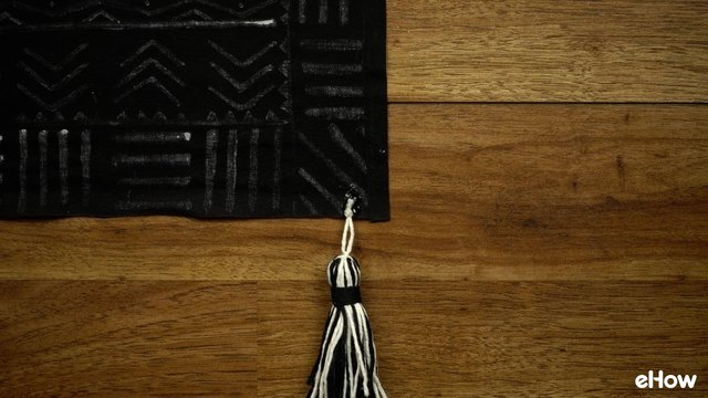 Tassel secured with glue. Let dry completely before handling.