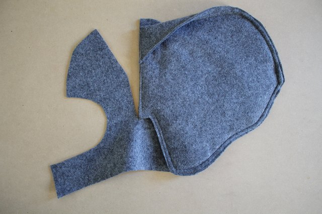 Pin an ear to each dart opening on the side of the hood.