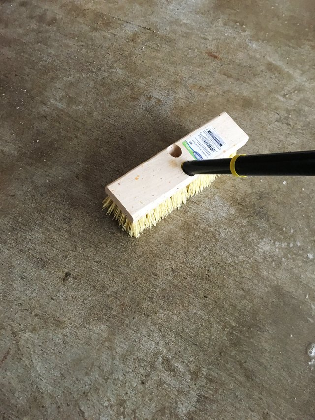 Brush the cleaner well into your concrete