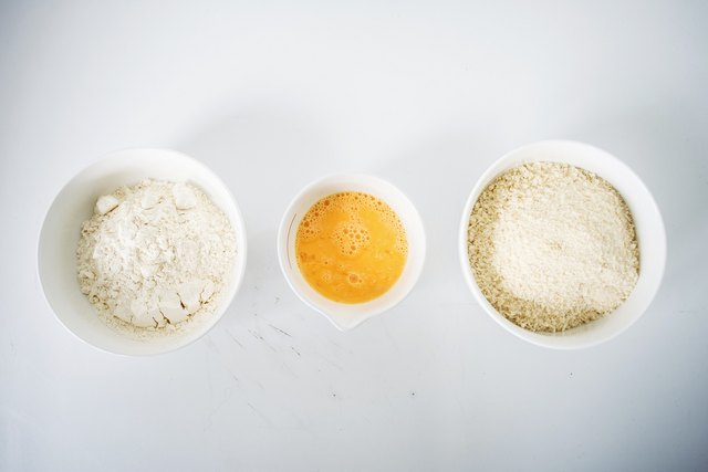 Put the flour, eggs and bread crumbs in three separate bowls.