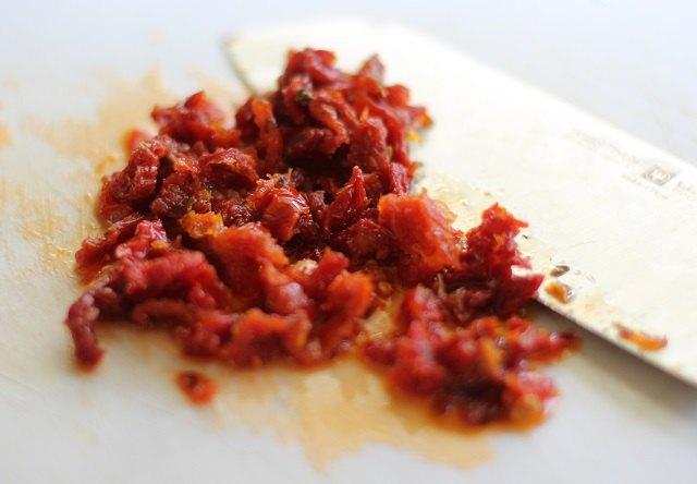 Chop the sun-dried tomatoes.