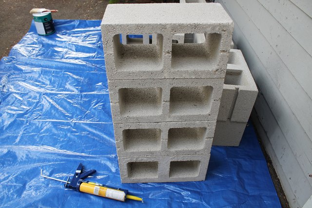 Four cinder blocks form the base of the structure.