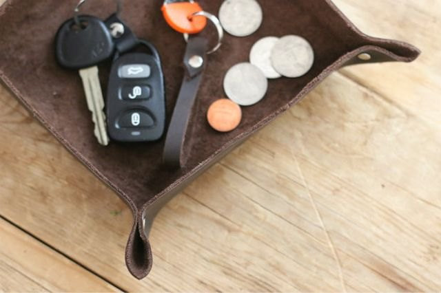 Rivets and leather offer a masculine touch for a simple valet tray.