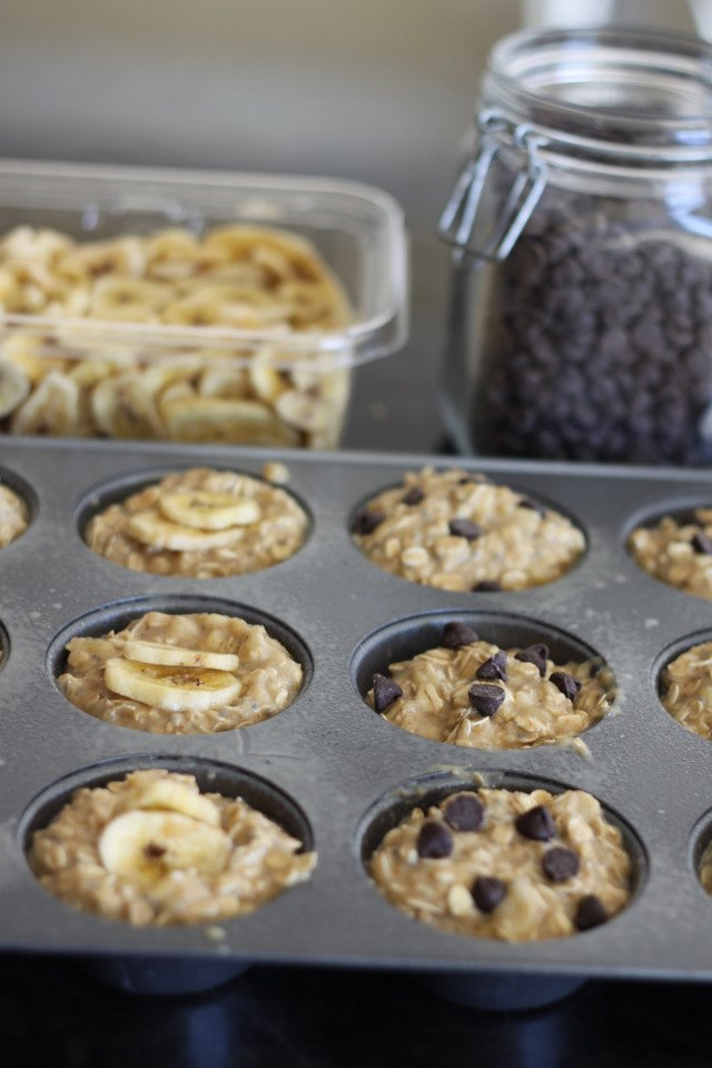 Tip: Place a couple of chocolate or banana chips in the bottom of each cup before ladling in the batter.