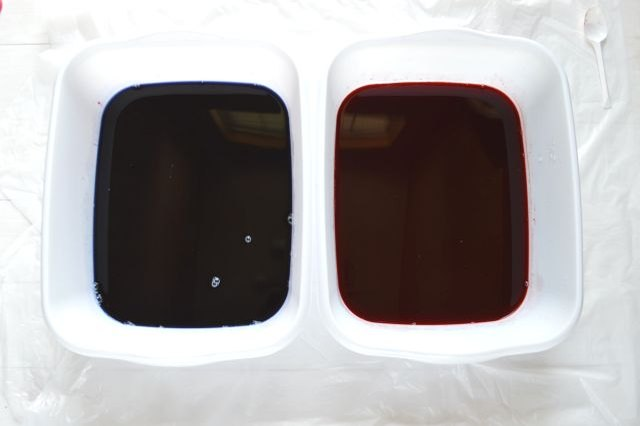 Prep the blue and red fabric dye in two separate bins.